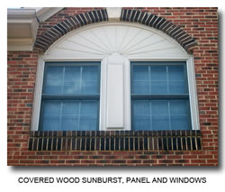 picture of a covered wood sunburst and window trim